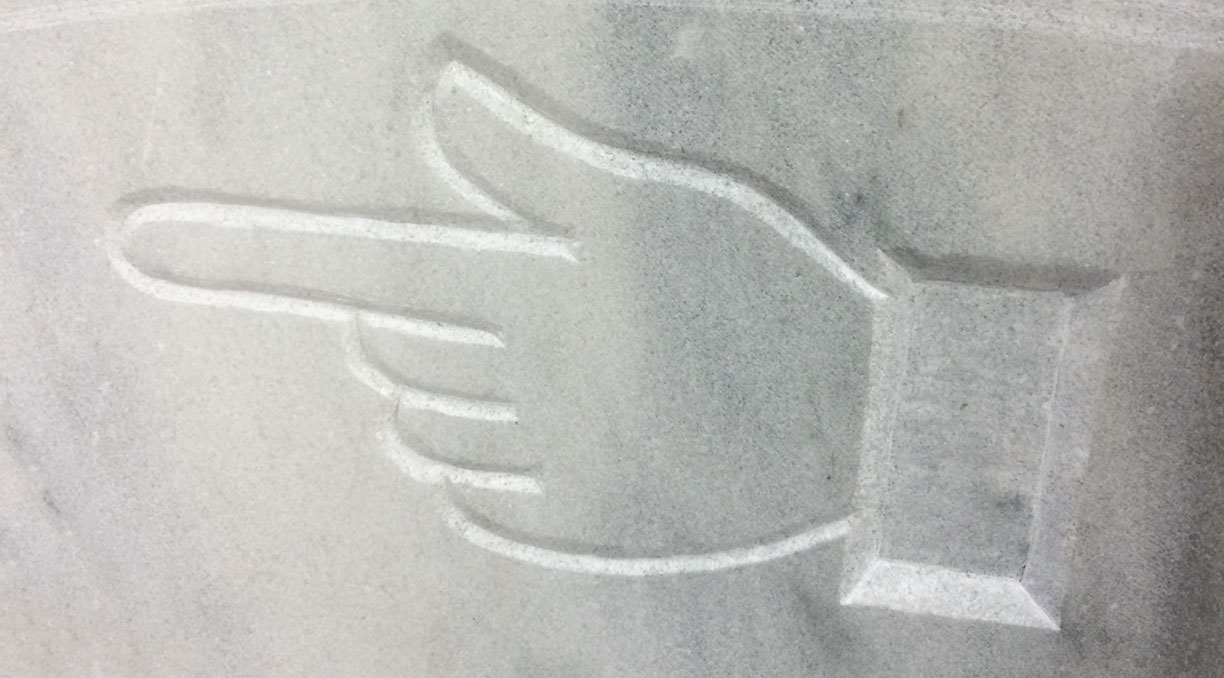 Manicule in white marble